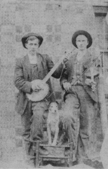Taylor Kimble, his dog Fido and friend circa 1910. Note Derringer in Taylor's banjo picking hand.