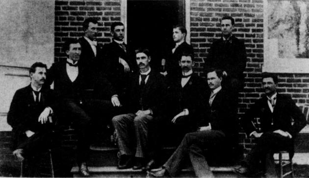 The teaching faculty of Shenandoah Collegiate Institute about 1900. W.H. Ruebush, 2nd from left. J.H. Ruebush, 4th from right.