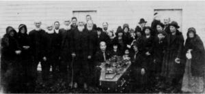 The funeral of Andrew Jackson Weddle, 1924 at Burkes Fork Church. His brothers and sister are on left of casket. His widow on right. His children by first marriage to Anna Harman are to right of widow.