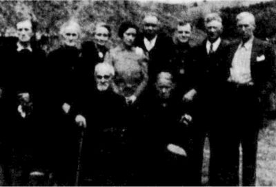 "Seated: Wilcher and Rhonda. First 3 standing from left are unknown, then Lillian, Caleb, ""Cana Lee"" (no. 9 child), unknown, Matt Bowman."