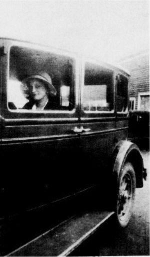 "Mrs. Louise P. Cobbs, ""Mrs. Doc"", driving family's 1928 Hupmobile, designed to hold the 5 boys who survived infancy."