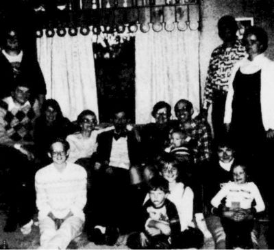 Maynard and Ethel Vass flanked by their children, in-laws and grandchildren.