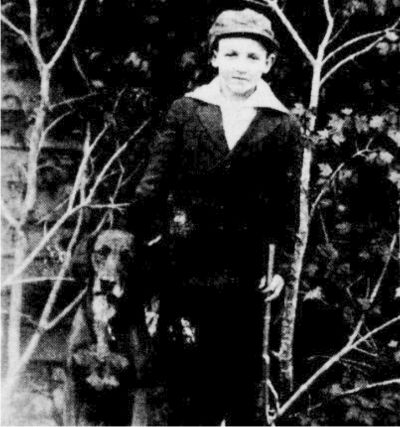 "Joseph Asa Thompson, about 11 years old, and his best dog, ""Drive"", a family pet and a red hound."
