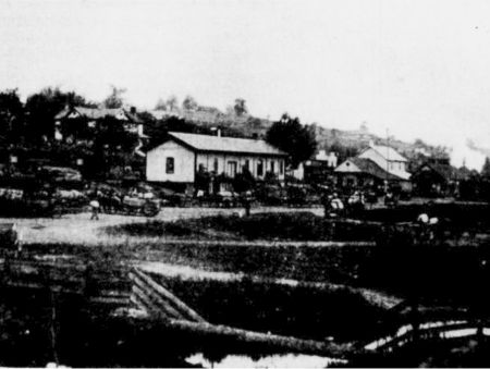 Photograph of the N. & W. Railroad Depot in 1872 in Crockett. The large house in the background is still standing today.