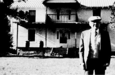 Preston S. Williams standing in front of the old homeplace in Meadows of Dan, Virginia.