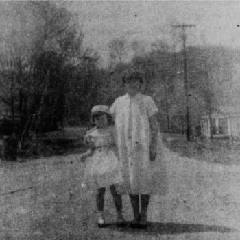 Photograph of Sylvia Sampson (left) and her older sister Gainelle Murry, taken in June of 1959.