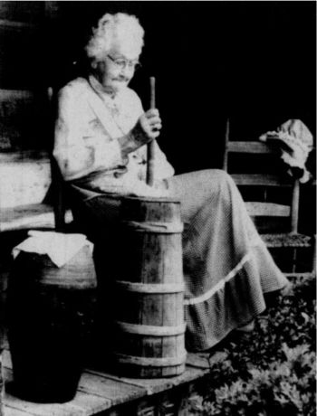 Sally Scruggs, shown here churning butter at the Museum of Appalachia in Norris, Tennessee. Photo: Tennessee Tourism Development. Front Cover photograph of May 1991 edition.