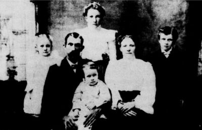 Standing, rear: Clarissa Candice Goad (Horton). Left to right: Macy Mae Goad (Williams), John Anderson Goad and wife Octavia Webb Goad, Daniel Rupert Goad. The baby on his father's knee is Isaac Booker Goad.