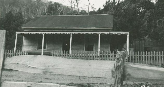 Image shows the front porch and fence of the D.C. Mangrum home. The house was built 4 years earlier, but it was razed for construction of the Blue Ridge Parkway. Inage taken by R.F.E. on May 28, 1936. Image taken near Rock Castle Gorge in the Rocky Knob area, near milepost 170 of the Blue Ridge Parkway.