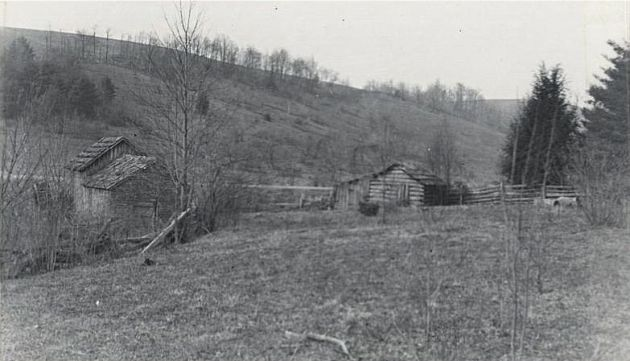 Image of Mabry Mill before it was restored near milepost 176.5, section 1T of the Blue Ridge Parkway. There are two structures in the photograph. Image taken from the National Park Service, Blue Ridge Parkway Headquarters. Photographed by Kenneth McCarter in 1941.