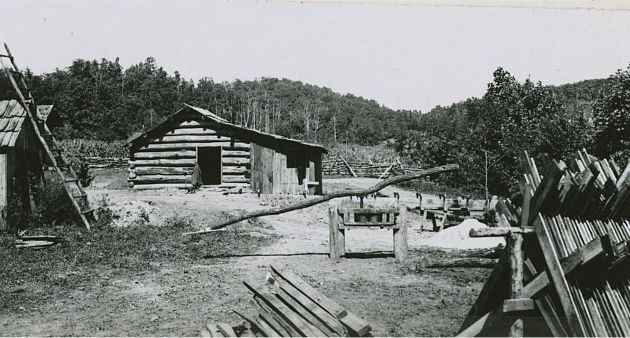 Image of a blacksmith shop at Mabry Mill near milepost 176.1, section 1T of the Blue Ridge Parkway. Photograph also shows the head of a flume and a sorghum mill. Image taken from the National Park Service, Blue Ridge Parkway Headquarters. Photographed by Kenneth McCarter in June of 1942.