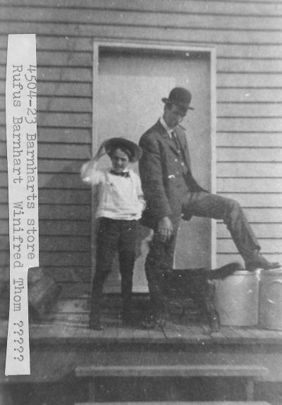 [4504-23] Rufus Barnhart and Winifred ( ? Thornton) at Barnhart's Store.